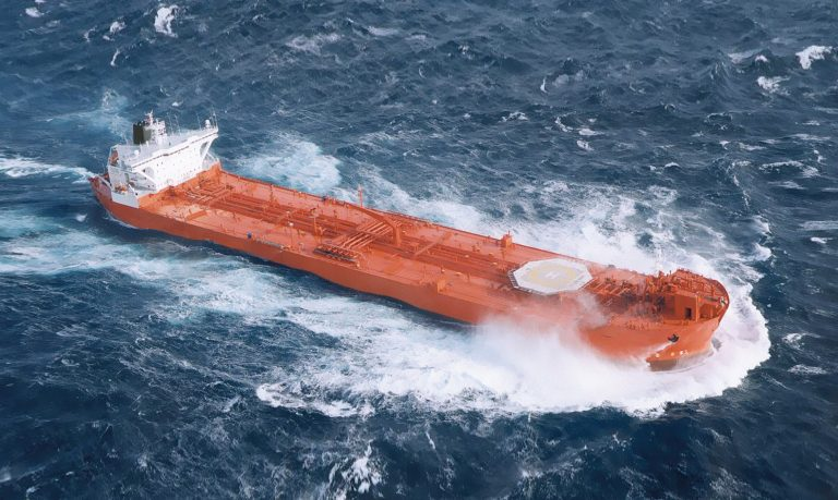 The large red vessel, Hanne Knutsen, travels at speed in rough seas